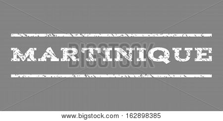 Martinique watermark stamp. Text tag between horizontal parallel lines with grunge design style. Rubber seal stamp with scratched texture. Vector white color ink imprint on a gray background.