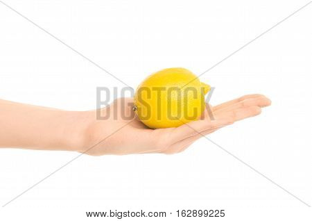 Healthy Eating And Diet Topic: Human Hand Holding Yellow Lemon Isolated On A White Background In The