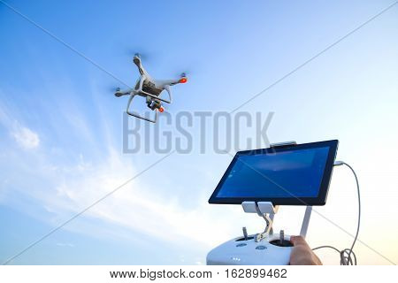 Russia Poltavskaya village - 28 August 2016: Quadrocopters 4 Phantom and a remote control for it. Quadrocopters against the blue sky. Umravlenie quadrocopters 4 Phantom.