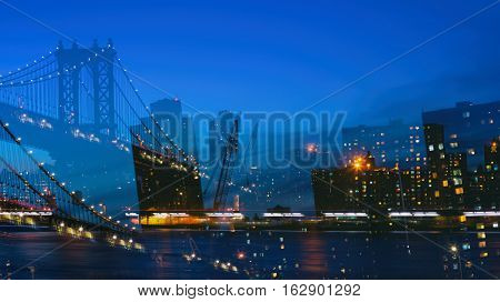 Abstract image with double exposure of Manhattan skyline and Manhattan Bridge in the evening in New York City.