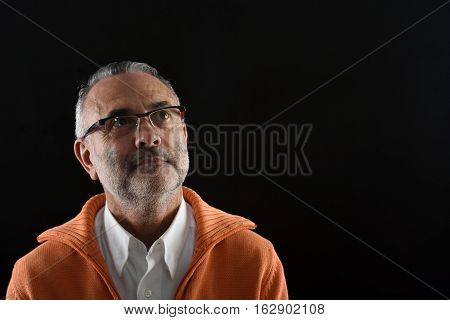 portrait of middle aged man on black