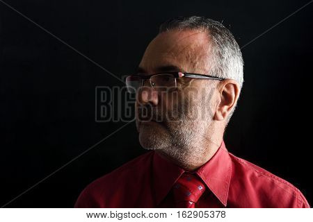 Portrait of a man with black background
