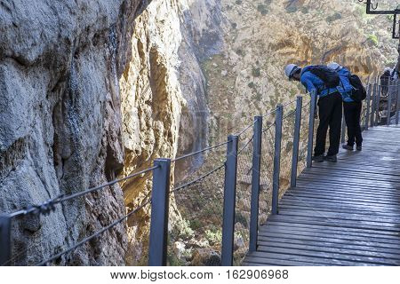 Visitors leaning out the footbridge along Caminito del Rey path Malaga Spain