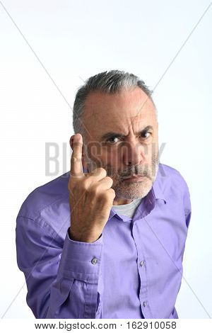 Man with threatening attitude with a white background
