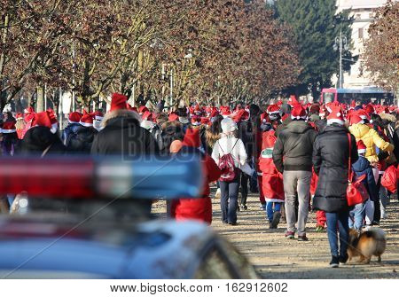 People With Red Santa Claus Hat And The Sirens Of Police Car