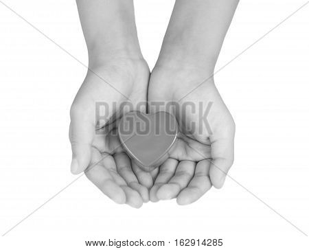 Heart Care, Medical Concept. Heart In The Hands Of A Child. Black And White Image