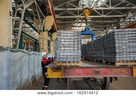 Tyumen, Russia - August 13, 2013: Block making department at construction material factory ZHBI-5. Workers in warehouse controlling products transportation