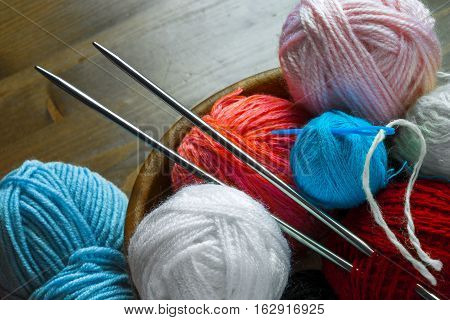 Colored thread for knitting with spokes and a plastic needle