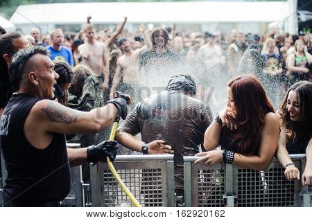TOLMIN, SLOVENIA - JULY 24TH: HEAVY METAL FAN ENJOYING BATH AFTER MUDD FIGHT THE METALDAYS FESTIVAL ON JULY 24TH, 2016 IN TOLMIN, SLOVENIA