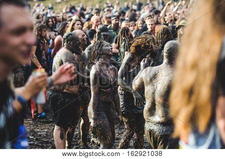 TOLMIN, SLOVENIA - JULY 24TH: HEAVY METAL FAN ENJOYING THE MUD ON THE METALDAYS FESTIVAL ON JULY 24TH, 2016 IN TOLMIN, SLOVENIA