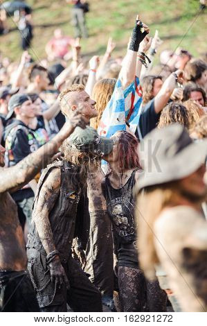 TOLMIN, SLOVENIA - JULY 24TH: HEAVY METAL FANS KISSING IN THE MUD ON THE METALDAYS FESTIVAL ON JULY 24TH, 2016 IN TOLMIN, SLOVENIA