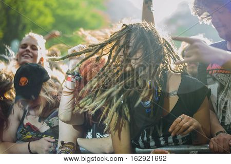 TOLMIN, SLOVENIA - JULY 24TH: HEAVY METAL FANS WITH DREADLOCKS HEADBANGING AT THE METALDAYS FESTIVAL ON JULY 24TH, 2016 IN TOLMIN, SLOVENIA