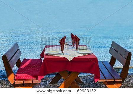 Served table on sea beach restaurant of Budva, Montenegro.