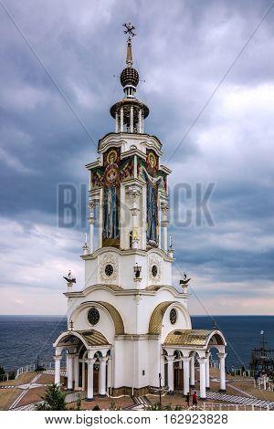 Crimea, Russia - May 30, 2016: Museum - lighthouse near Yalta. Monument to lost seamen. Orthodox church