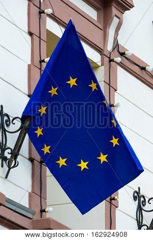 EU flag. European Union flag. Flag attached to the building.