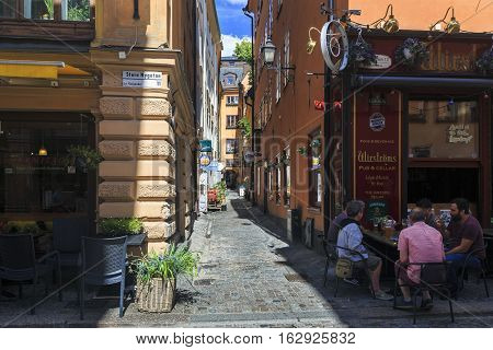 STOCKHOLM, SWEDEN - JUNE 27, 2016: This is one of the old alleyways of Gamla Stan.