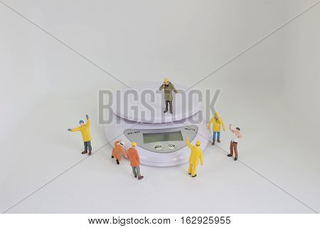 Miniature People In Engineer Or Worker