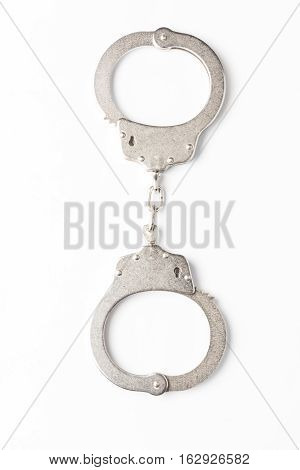 Handcuffs isolated on white background high quality and high resolution studio shoot