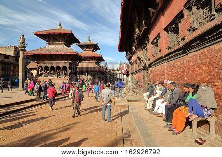 PATAN, NEPAL - DECEMBER 20, 2014: The main street along the temples at sunset at Durbar Square