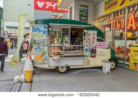TOKYO - 21 NOV 2016: Food truck at Akihabara area in Tokyo, Japan. The area is a major shopping area for electronic, telecommunication, computer, anime, games and otaku goods.