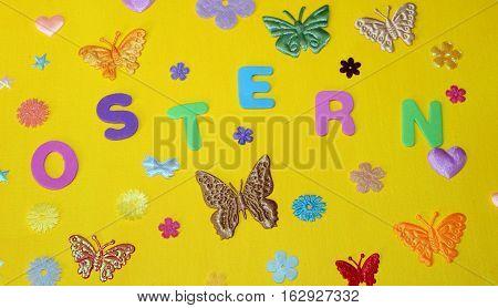 Easter moths stars flowers on a yellow background Ostern Motten Sterne Blumen auf einem gelben Hintergrund