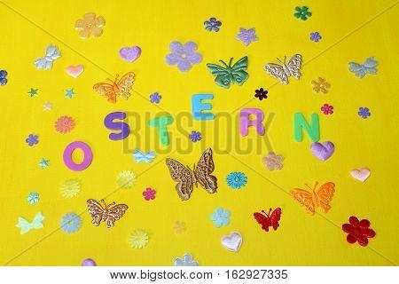 Easter holiday Easter Spring moths stars flowers on a yellow background Ostern Ostern Frühjahr Motten Sterne Blumen auf einem gelben Hintergrund