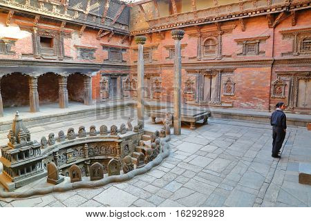 PATAN, NEPAL - DECEMBER 21, 2014: Courtyard of Mul Chowk Royal Palace with a Royal Stepwell, Durbar Square