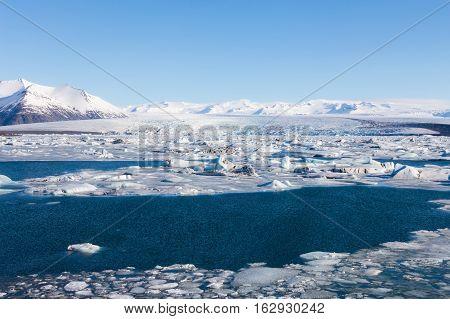 Iceland winter natural lagoon, natural winter season landscape background