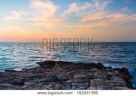 Beautiful sky over seacoast over rocky beach over ocean skyline
