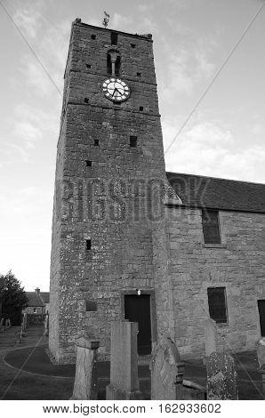 An external view of the church clock tower in Dunning