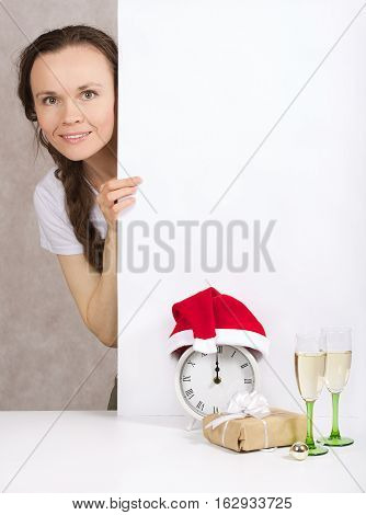 Young Lady In Santa Claus Hat