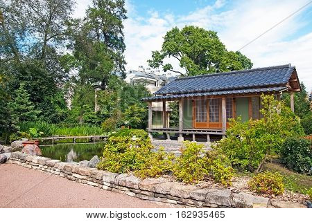 SAINT-PETERSBURG, RUSSIA, AUGUST 3, 2016: Fragment of The Japanese Garden with tea house in Peter the Great Botanical Garden (Botanic Gardens of the Komarov Botanical Institute)