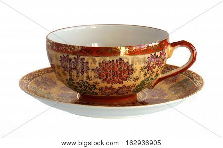 An empty antique porcelain cup and saucer isolated on white background