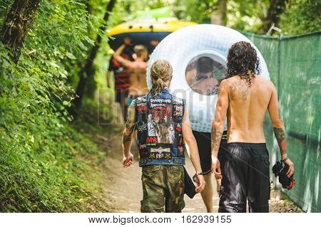 TOLMIN, SLOVENIA - JULY 25TH : HEAVY METAL FANS HAVING A PARTY AT THE RIVER SOCA ON THE METALDAYS FESTIVAL ON JULY 25TH, 2016 IN TOLMIN, SLOVENIA