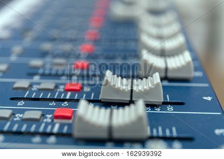Audio mixer amplifier equipment, sound acoustic musical mixing engineering concept background, selective focus. stock photo