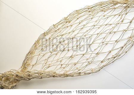 fishnet diagonal detail on a white background