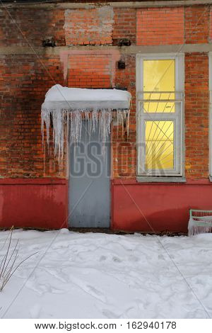 Icicles On The Cornice Of The Building