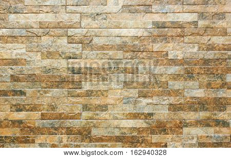 ceramic tile under a brick on the wall