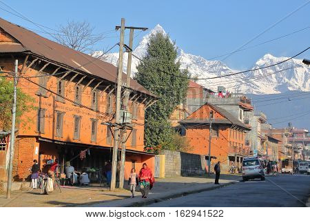 POKHARA, NEPAL - JANUARY 9, 2015: Pokhara old town with the Himalayan mountains in the background