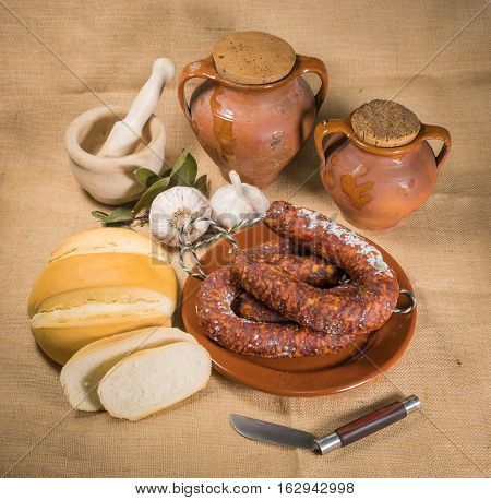 Still life with Iberian Pork Sausage and Handcrafted Bread
