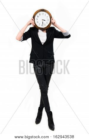 Businesswoman with clock ful height - time concept