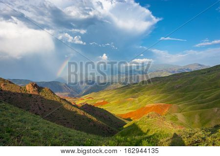 Beautiful Mountain Landscape With Bright Rainbow, Kyrgyzstan.