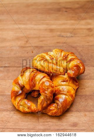croissant bakery on teak wood table. Stock photo
