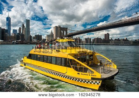NEW YORK CITY NOVEMBER 19: The New York Water Taxi on the route on August 20th 2015 on the Hudson River. New York Water Taxi offer taxi services on the East and Hudson rivers.