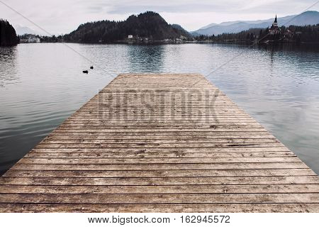 Wooden pier at the beautiful  lake water.