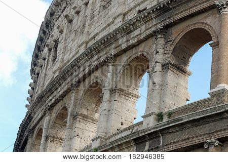 Coloseum details on a blue sky Rome Italy