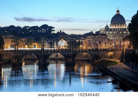 Famous Landmark St. Peter Basilica And Sant'angelo Bridge At The Sunset Reflection On Tiber River Ro