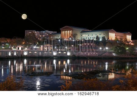 Moon over the Philadelphia Art Museum and historic Fairmount waterworks along the Schuylkill river.