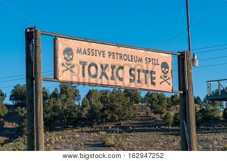 Toxic Site sign at the site of a petroleum spill