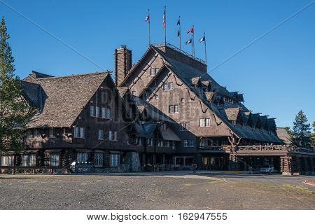 YELLOWSTONE, WY - SEPTEMBER 27, 2016: Exterior of the historic Old Faithful Inn in Yellowstone National Park Wyoming. Built in 1904 the inn is considered to be the largest log structure in the world.